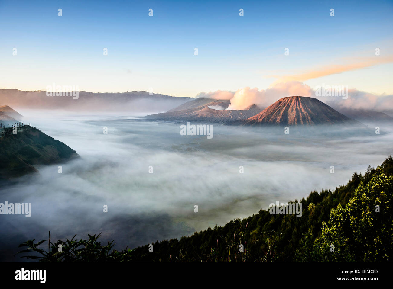 High angle view of clouds under smoking volcano - Stock Image