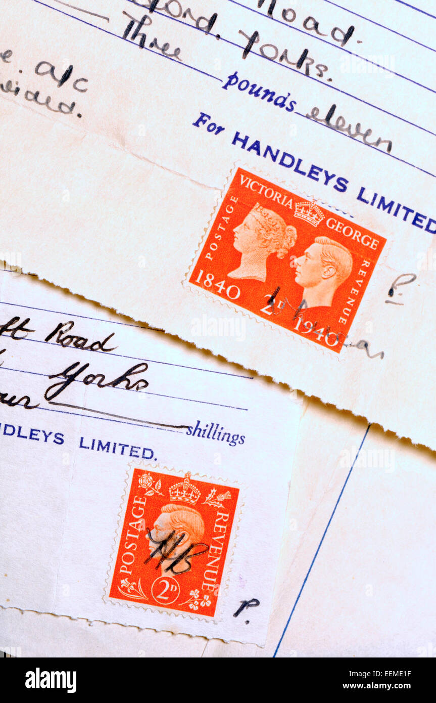 Postage stamps used to legally validate receipt - George V, 1941 - Stock Image