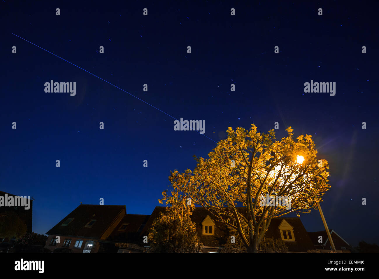 A long exposure of the International Space Station (ISS) and its track overhead. - Stock Image