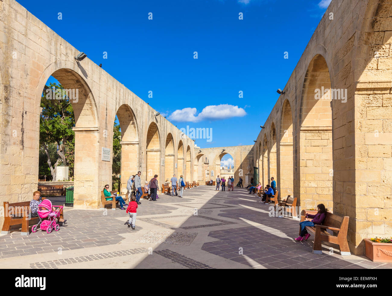 Tourists in Upper Barrakka Gardens overlooking the Grand Harbour Valletta Malta EU Europe - Stock Image