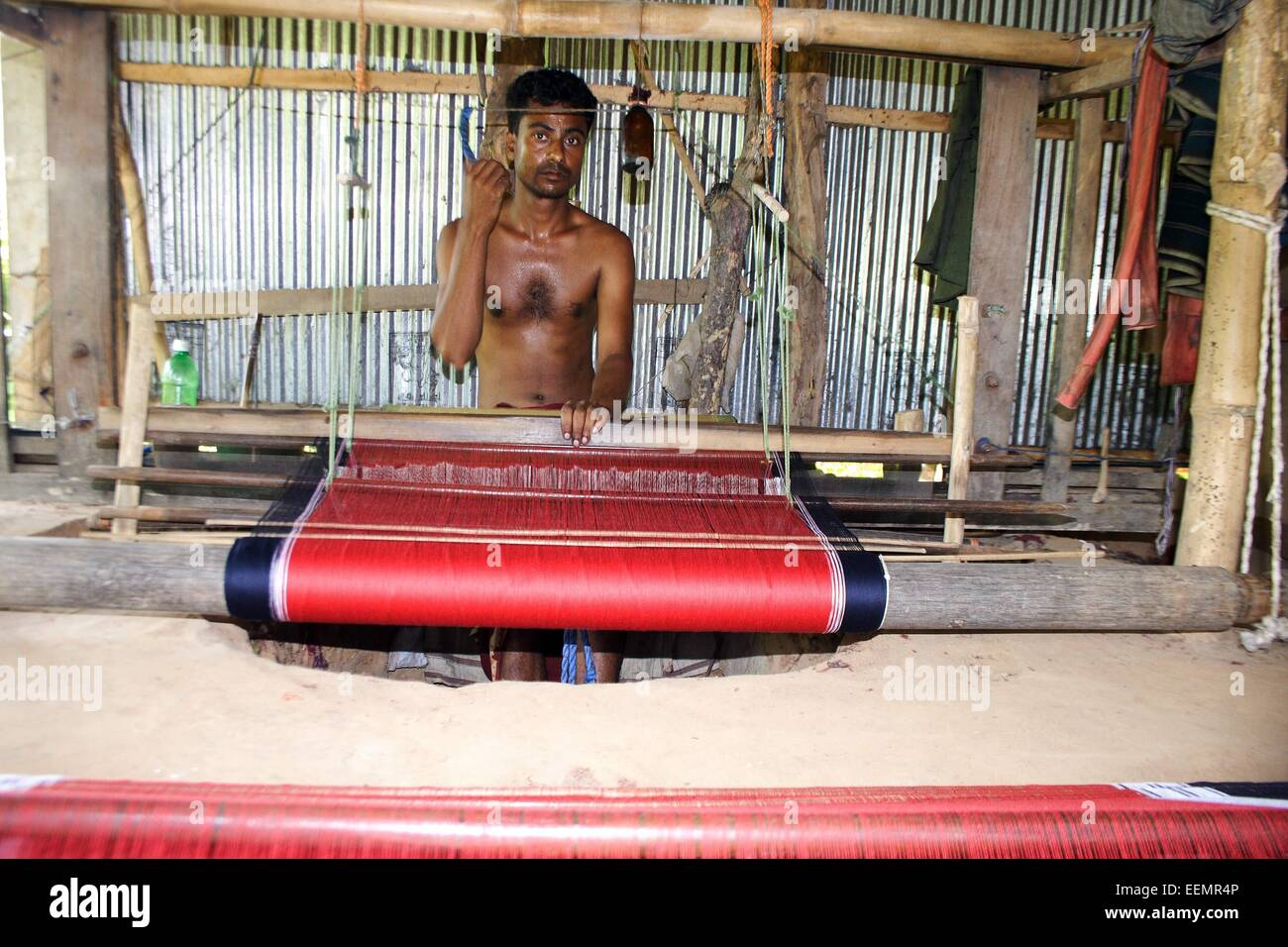 Bangladesh 10 January 2015. A Tribal man weaving cloth on an old traditional loom. - Stock Image