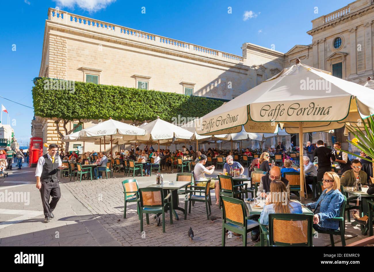 Tourists at the Cafe Cordina Piazza Regina Valletta Malta EU Europe - Stock Image