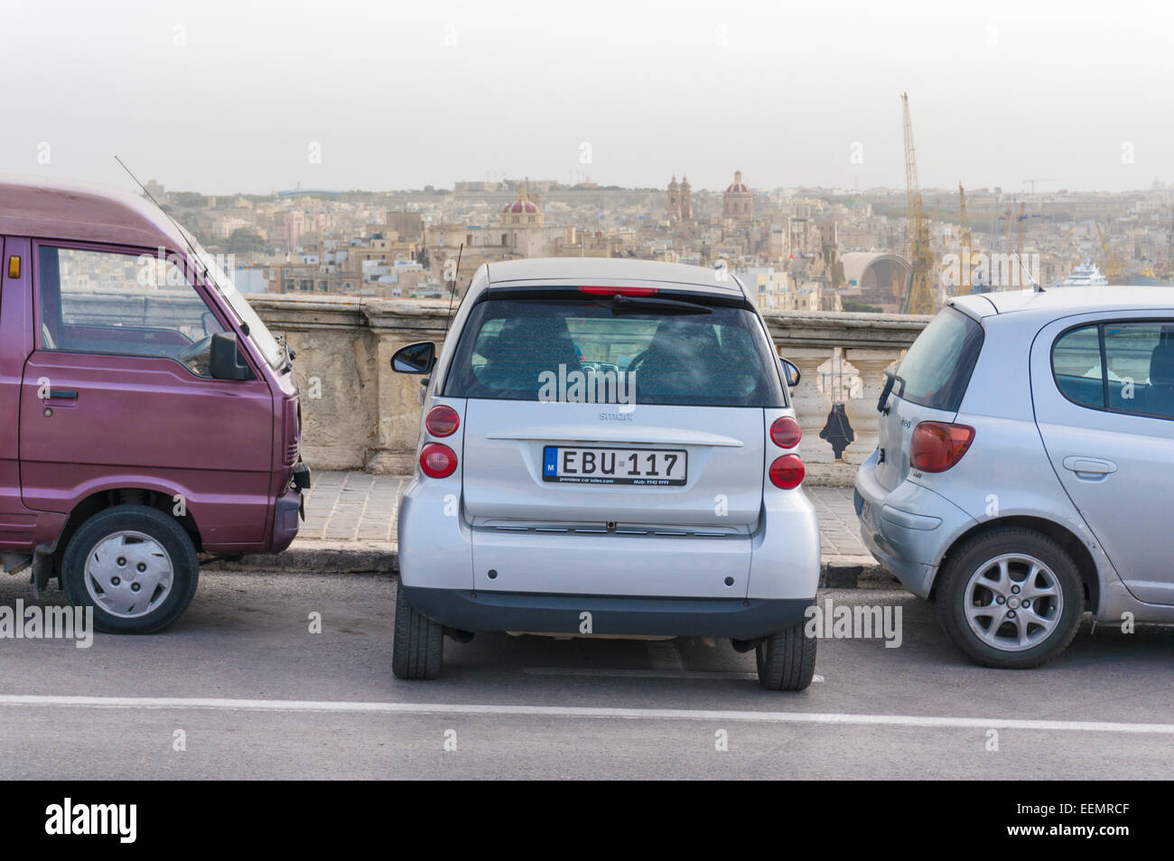 Smart Car Parked between in small space between two cars VallettaMalta EU Europe - Stock Image