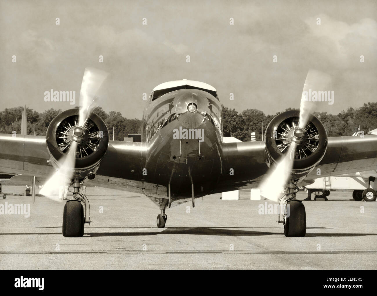Front view vintage propeller airplane running engines Stock Photo