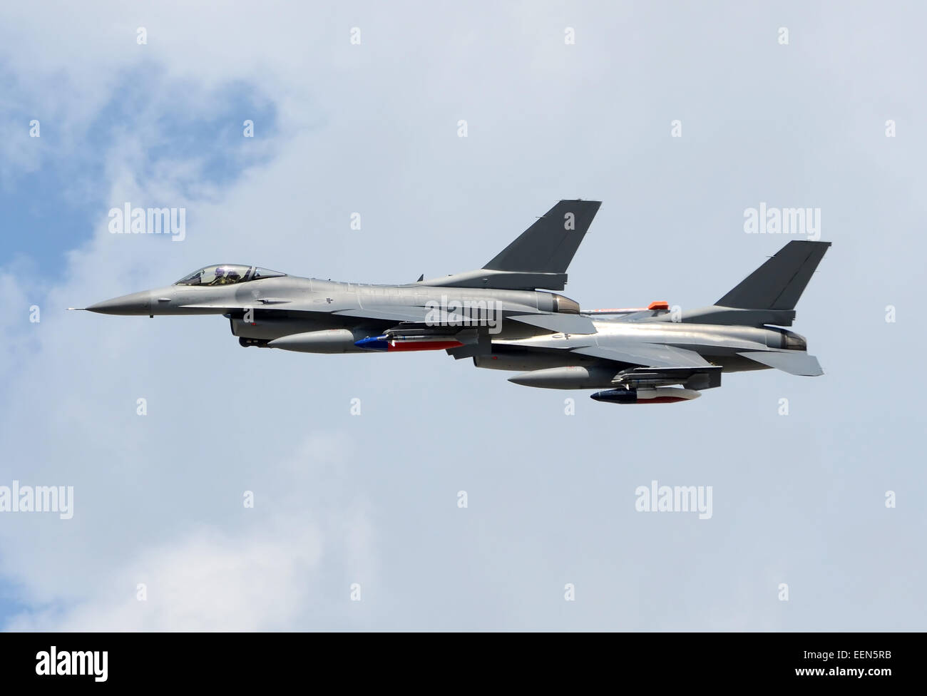 Two modern F-16 fighter jets at high altitude - Stock Image