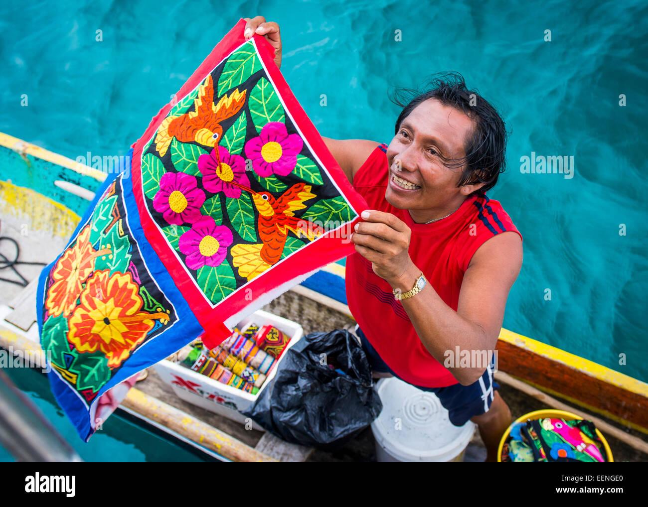 Kuna salesman selling colourful cloth, San Blas Islands, Panama - Stock Image