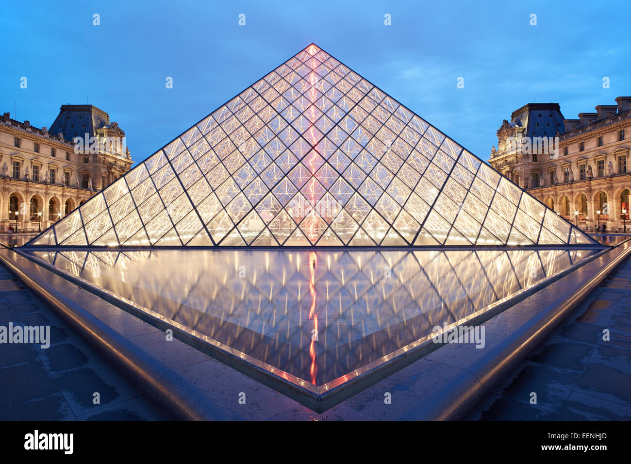Louvre pyramid and museum night view in Paris, France Stock Photo