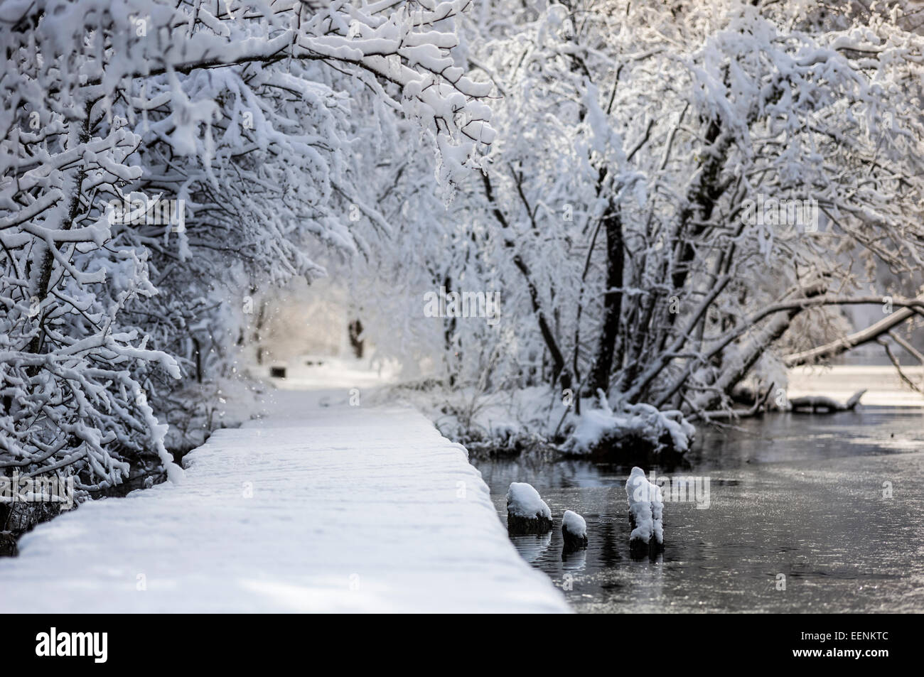 Snow-clad road near the water. - Stock Image