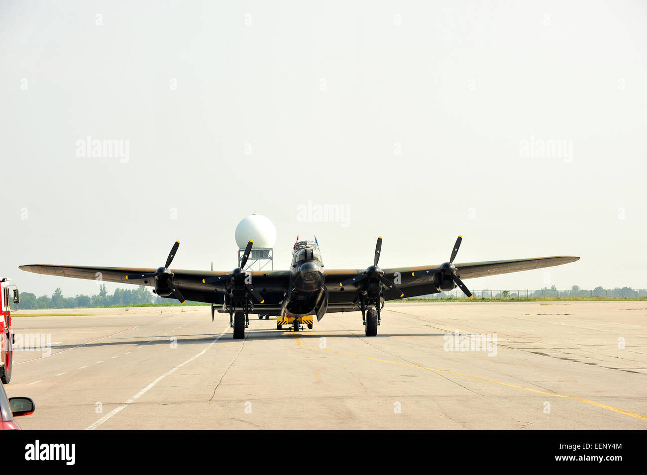 An Avro Lancaster Being Towed To The End Of A Runway Prior To Stock Photo Alamy