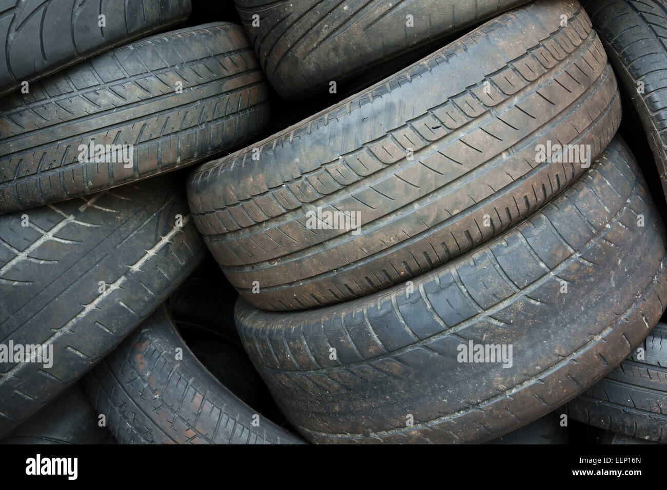 Pile of old worn out tires for recycling - Stock Image