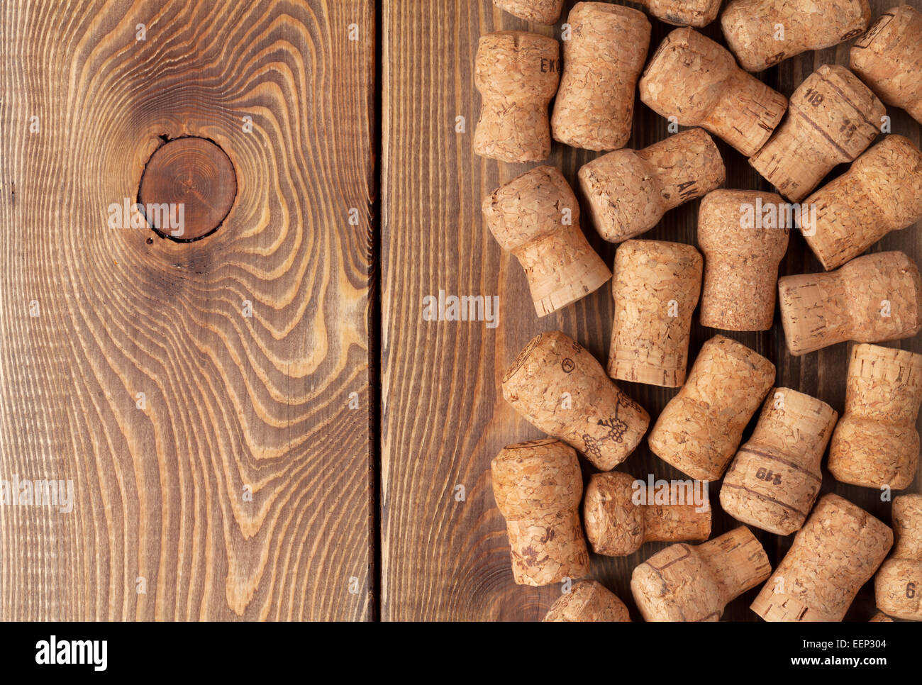 Champagne wine corks over wooden table texture background - Stock Image