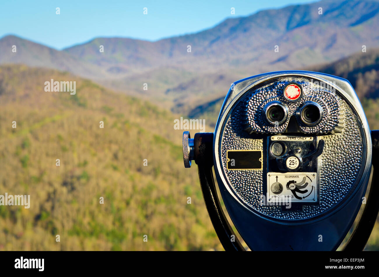 Coin binoculars with mountain view at a distance - Stock Image