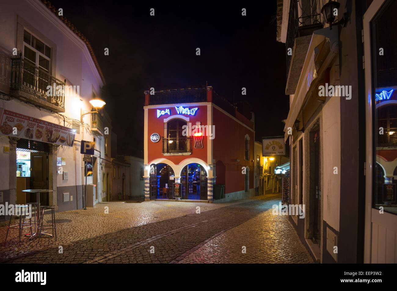 Bar at night with neon signs in the town centre of Lagos in the western Algarve, Portugal - Stock Image