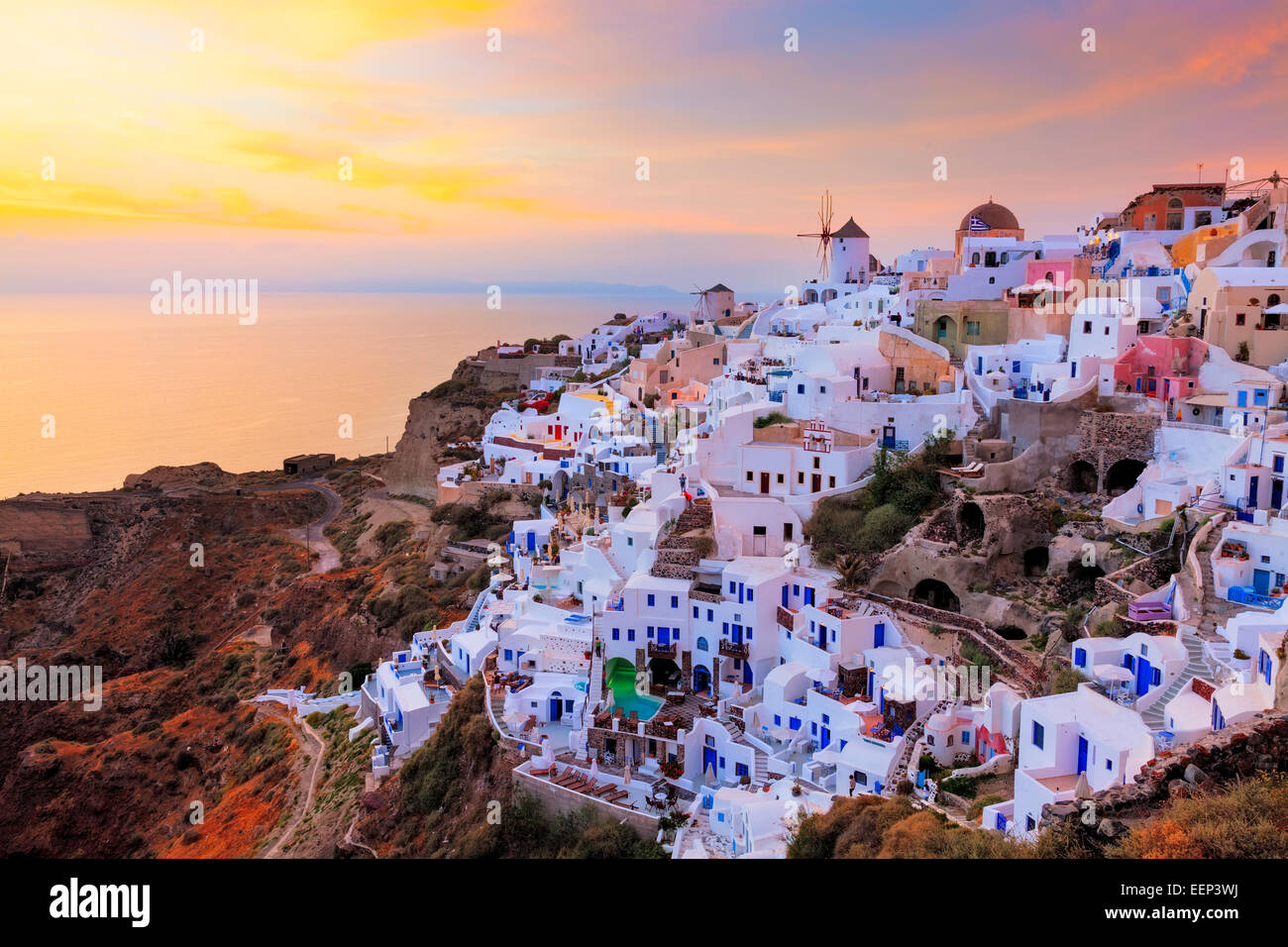 Vibrant sunset over houses and villas at Oia Santorini Greece - Stock Image