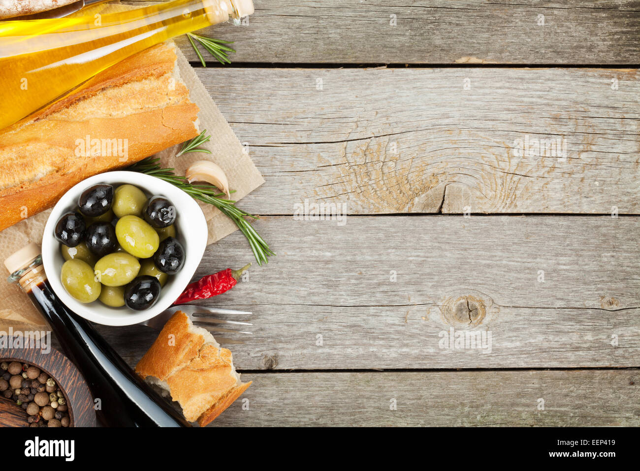 Wooden Food Table ~ Italian food appetizer of olives bread and spices on