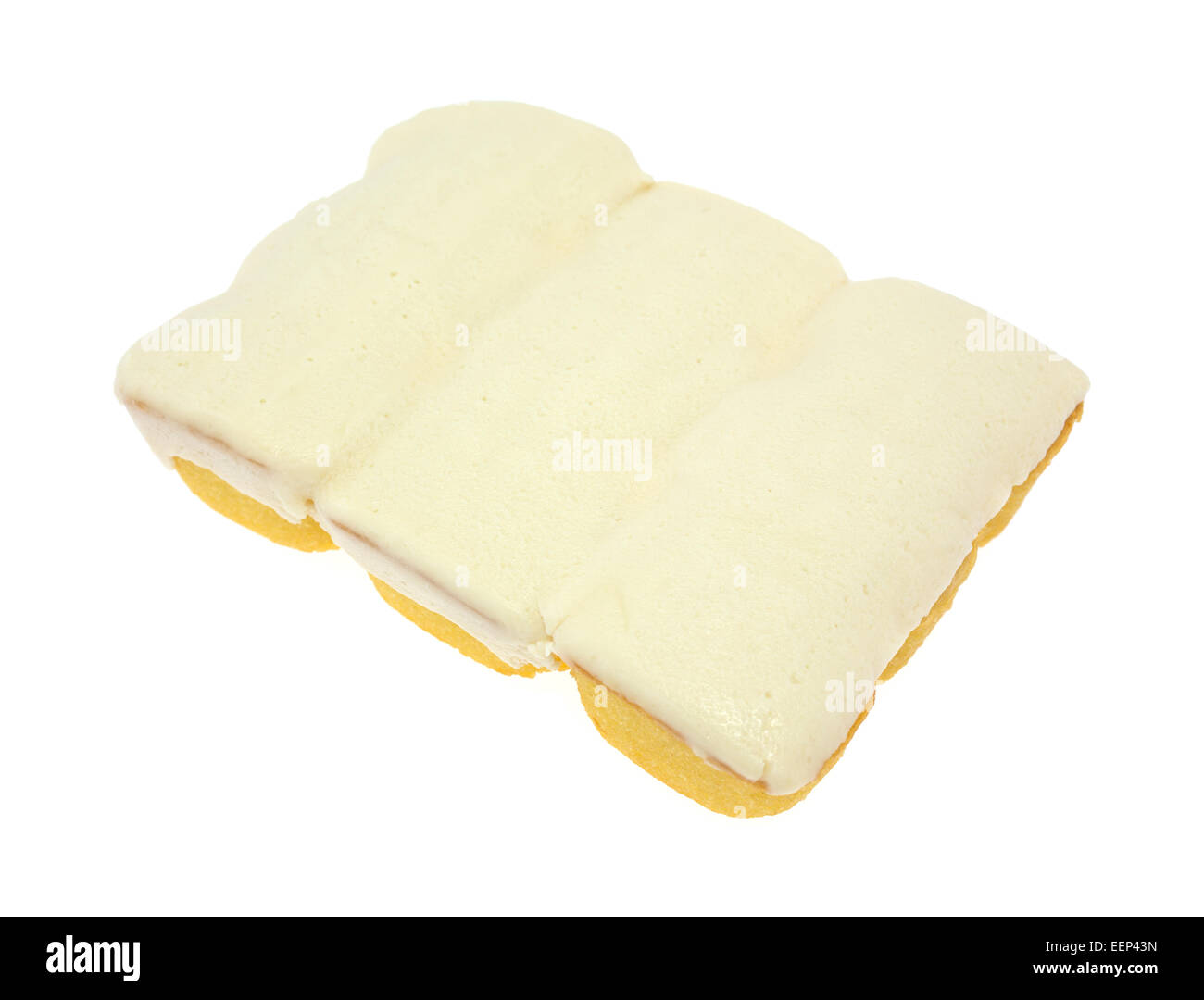 Three bite size yellow snack cakes with vanilla icing on a white background. - Stock Image