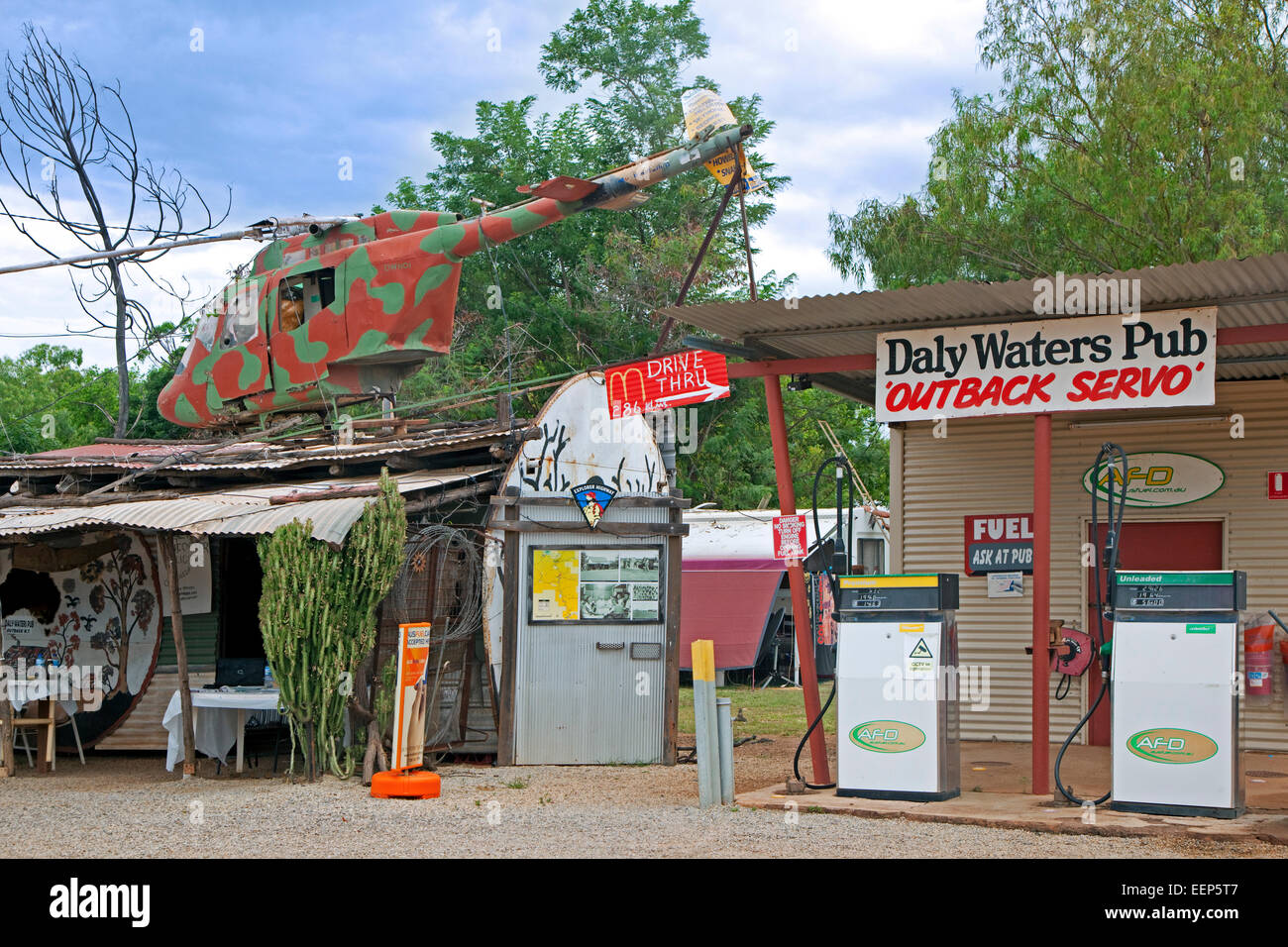The Daly Waters Pub Outback Servo with old helicopter along the Stuart Highway, Northern Territory, Australia - Stock Image