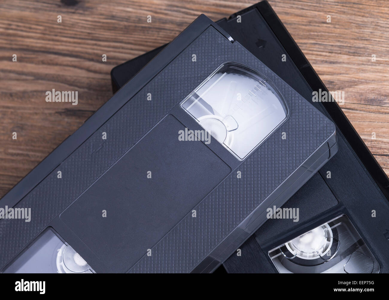 Image shows two old retro video tapes on a wooden table Stock Photo