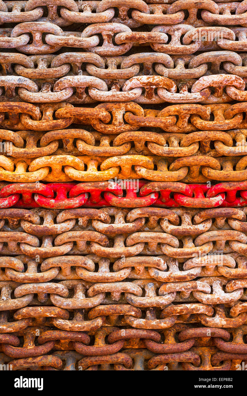 Multicoloured chains in an engineering workshop. - Stock Image