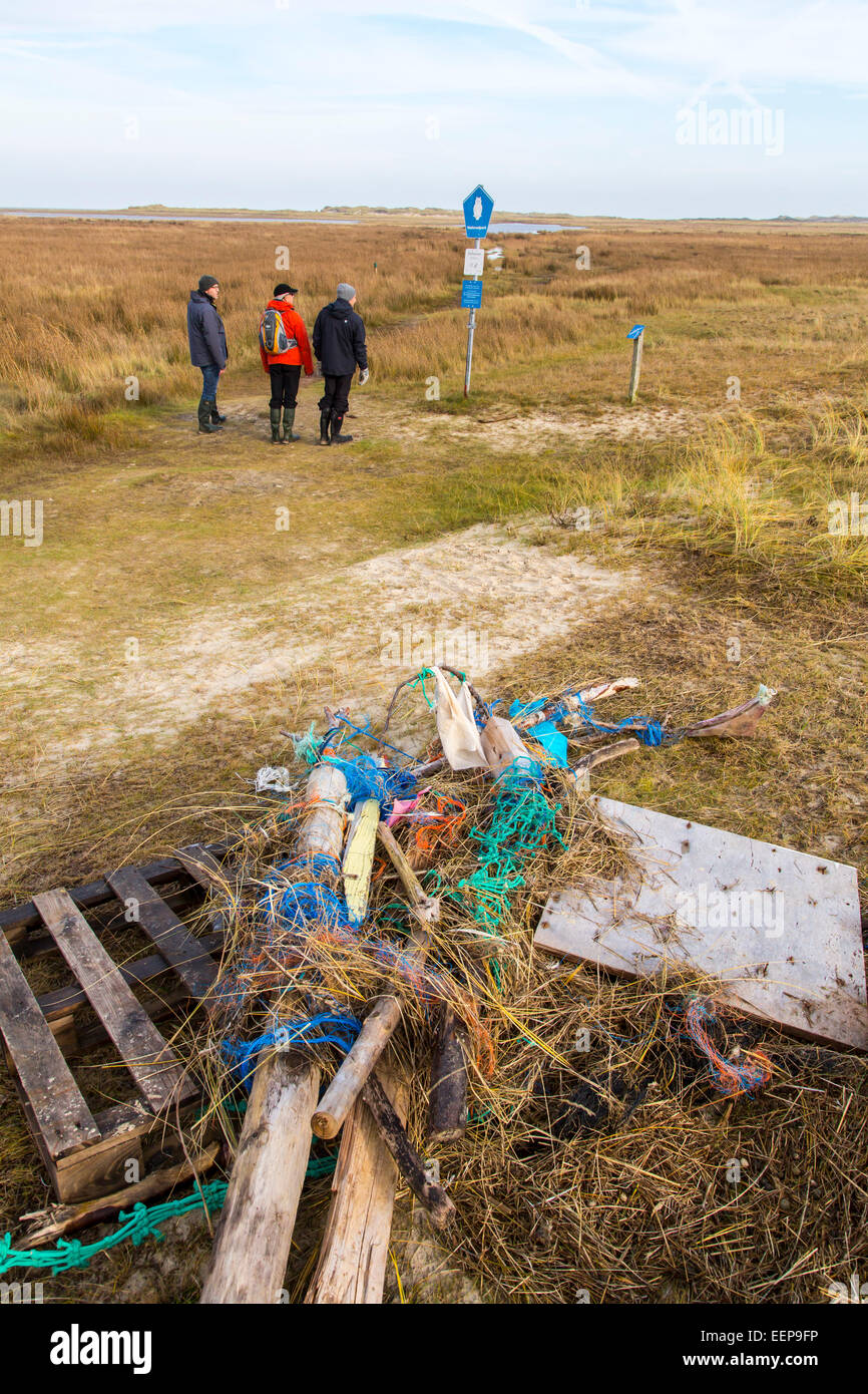 North Sea island of Spiekeroog, beachcomber wood and plastic parts, washed ashore on the beach, dunes - Stock Image
