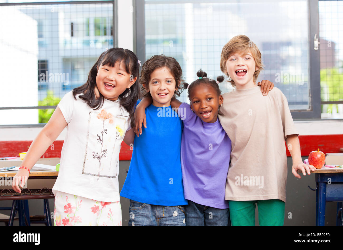 Multi ethnic classroom. Afro american, asian and caucasian primary ...