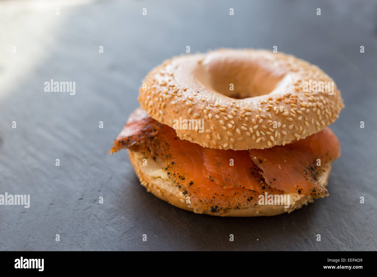 Peppered Salmon with a Sesame Bagel - Stock Image