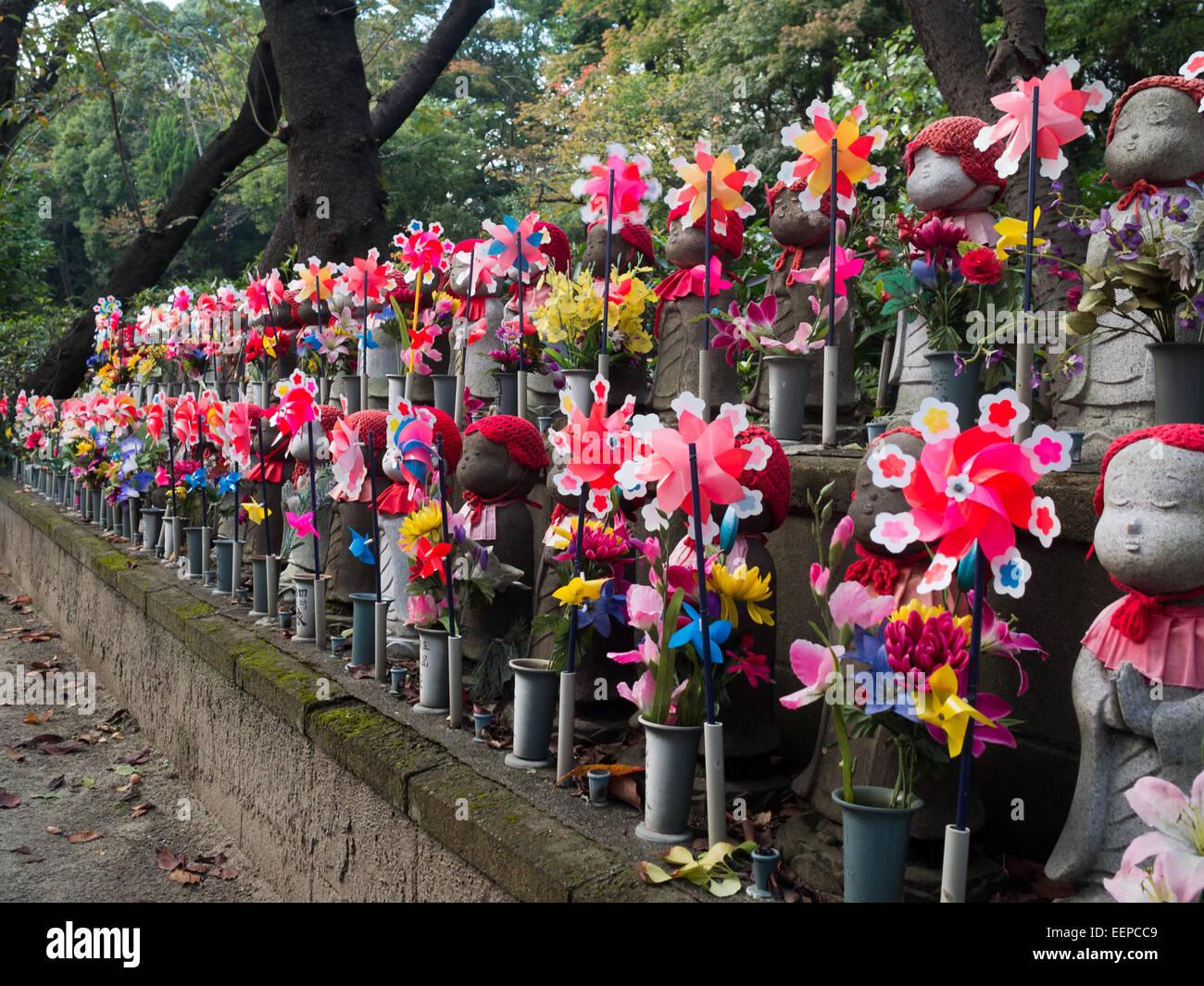 Zojo-jo stone dolls dressed in memory of deceased children Stock Photo