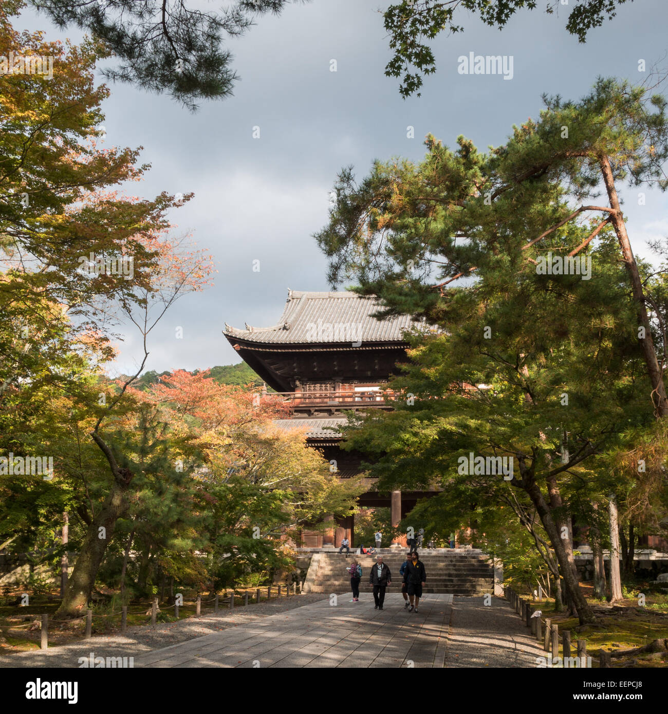 Entrance to the Nanzen-ji temple fround with San-mon Zen gate behind the trees - Stock Image