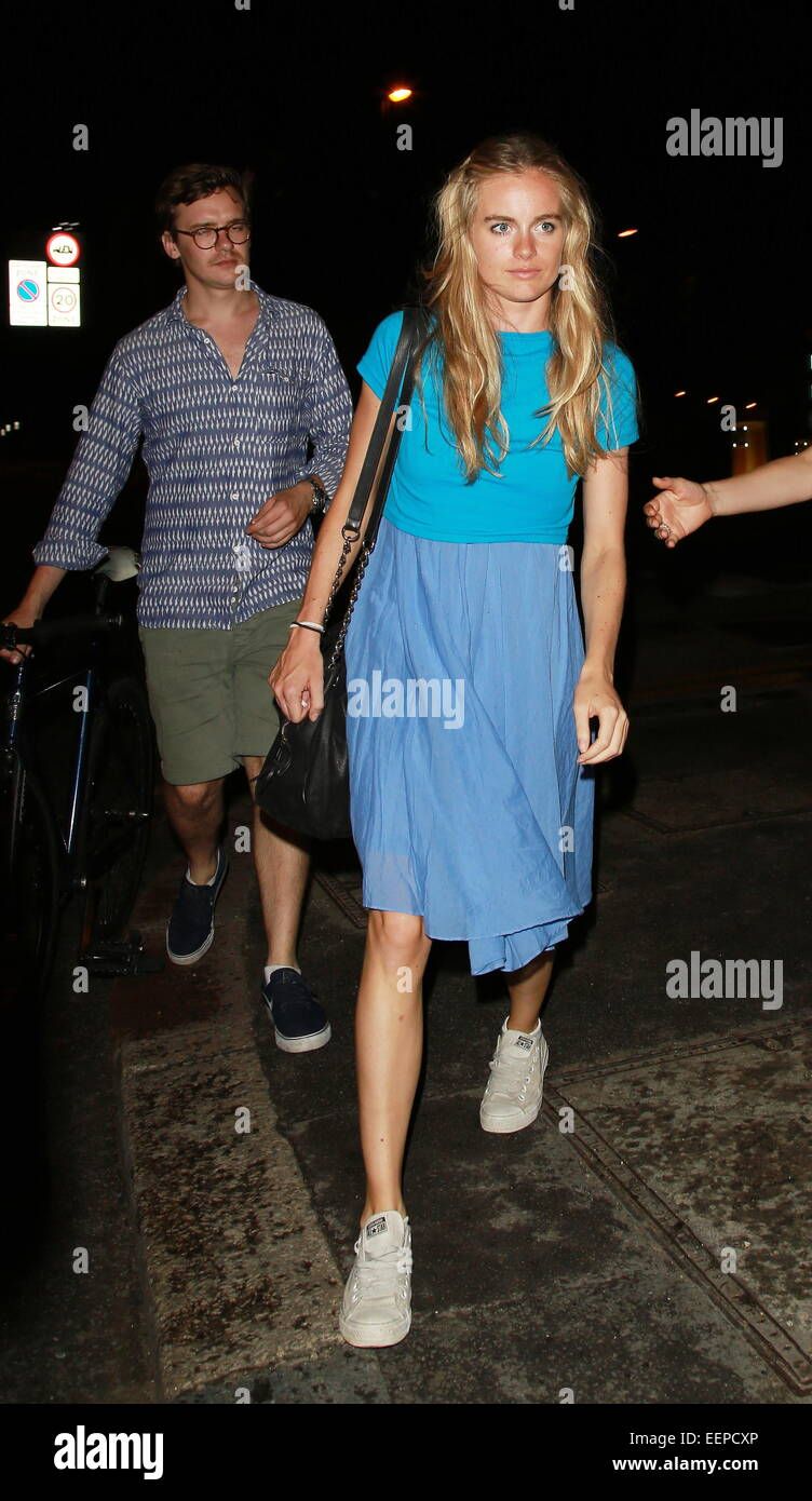 Cressida Bonas clutches a cigarette in her right hand as she leaves the Rosemary Branch Theatre after a performance - Stock Image