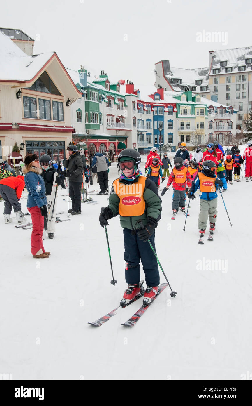 Children taking a ski lesson at Mt Tremblant ski resort, province of Quebec, Canada. - Stock Image