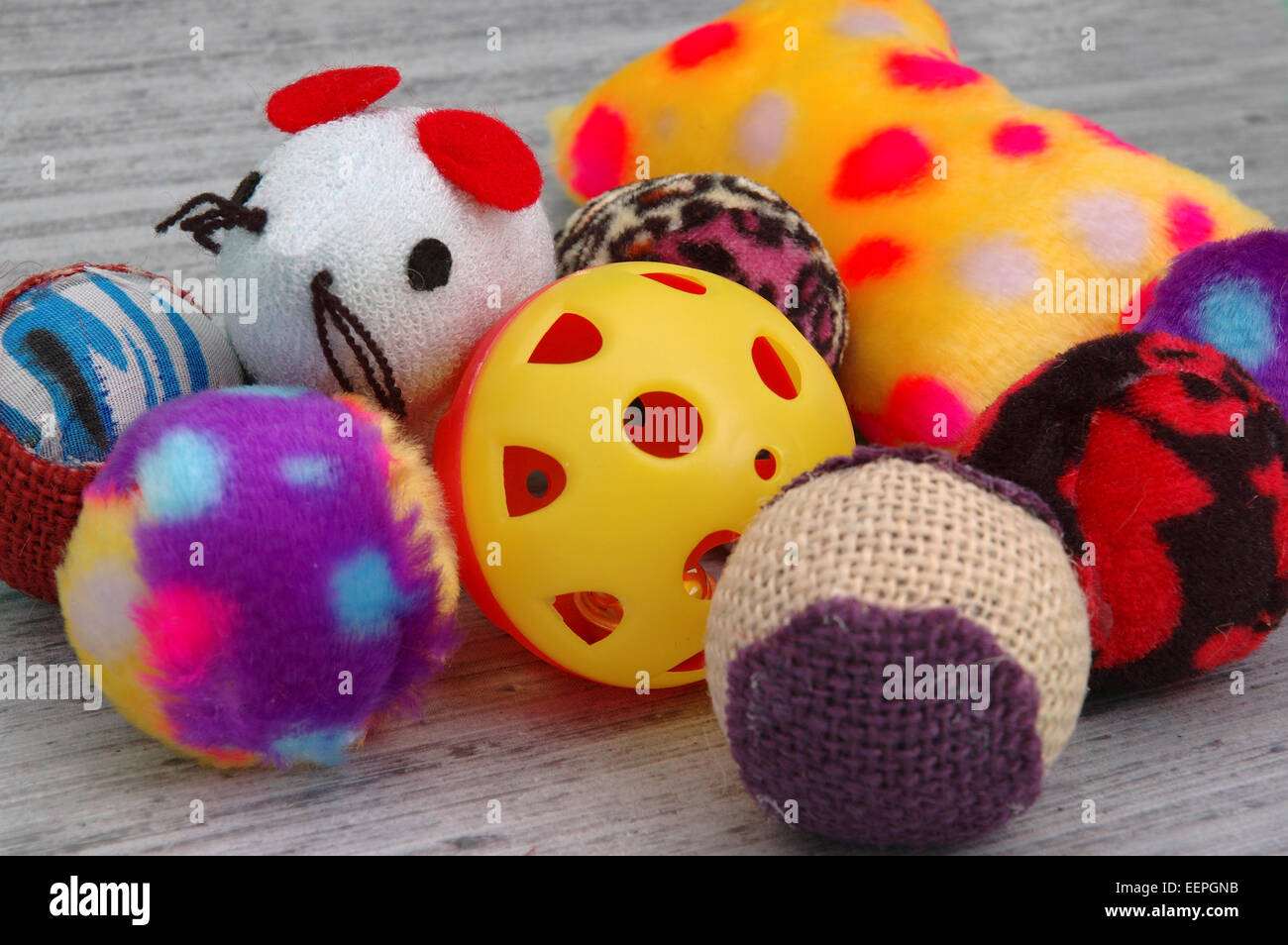 Assortment of cat toys of different colors, shapes and textures. - Stock Image