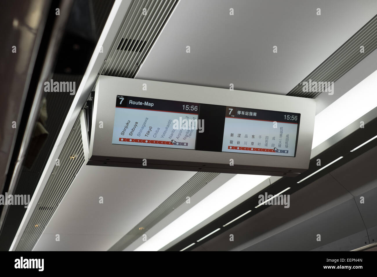 Map and station display on the NEX train from Japan's Narita International airport (NRT) and downtown Tokyo. - Stock Image
