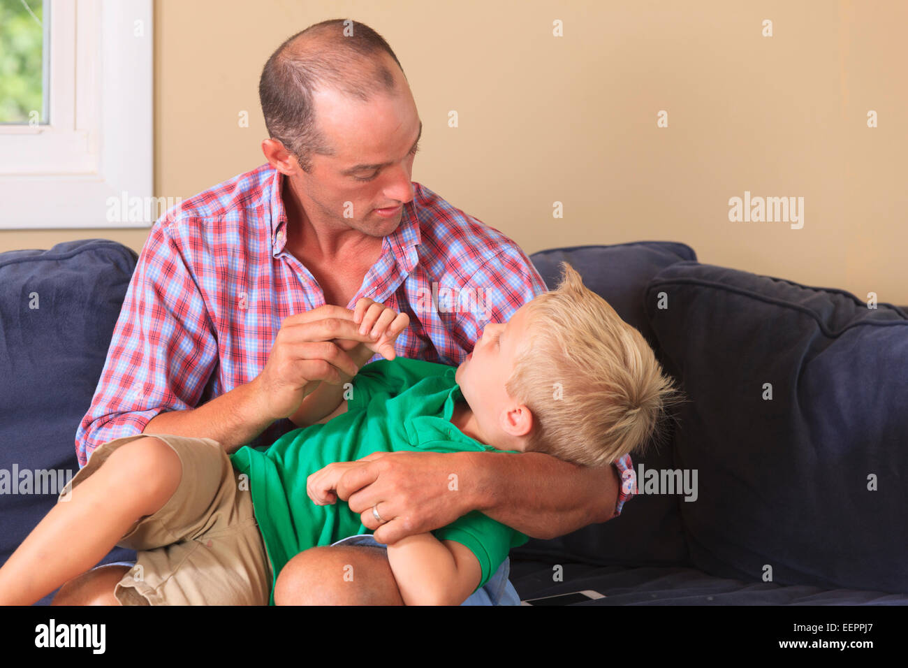 Father and son with hearing impairments signing 'no' in American sign language - Stock Image