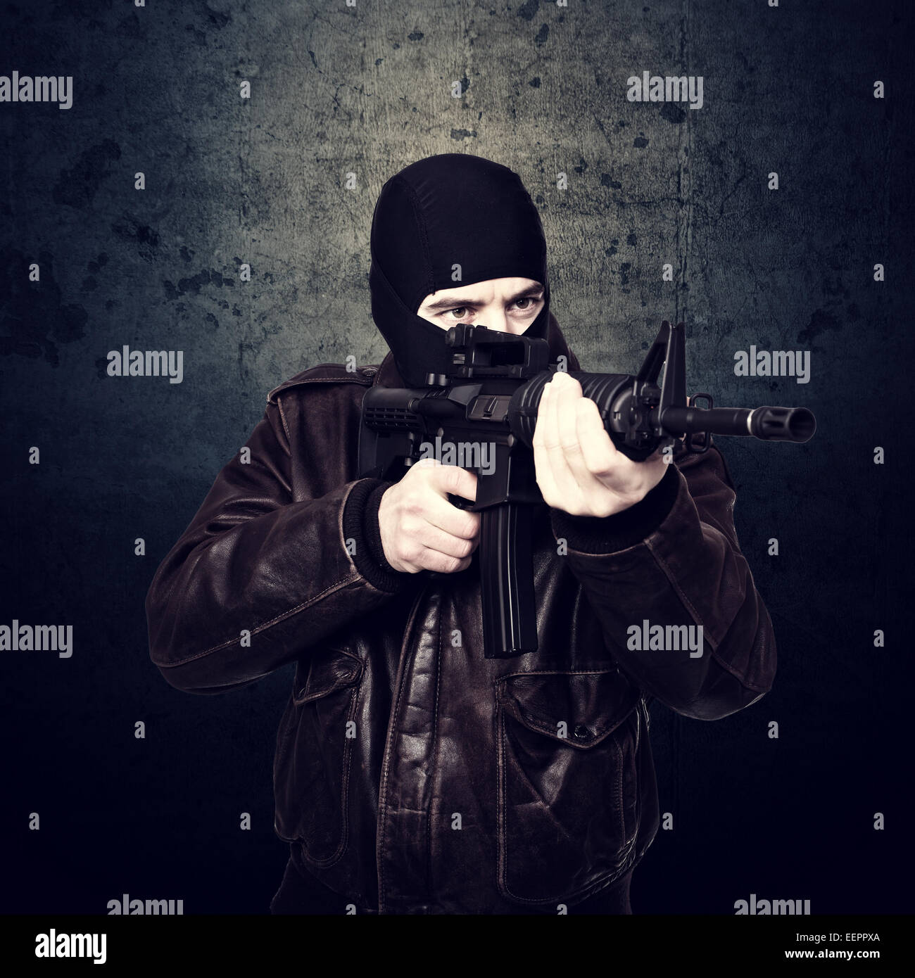 portrait of terrorist and grunge background - Stock Image