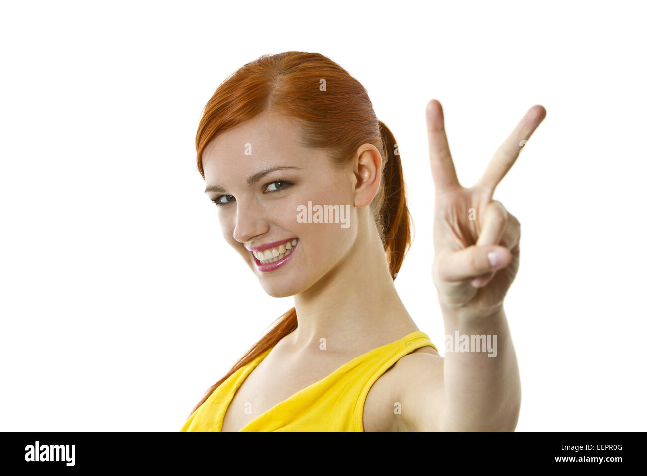 Junge rothaarige Frau zeigt Victory Zeichen, Young red-haired woman shows victory sign, attractive, beautiful, beauty, - Stock Image