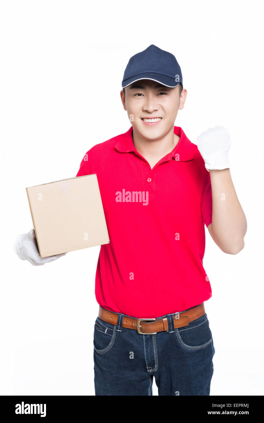 delivery man carrying cardboard box, white background. - Stock Image