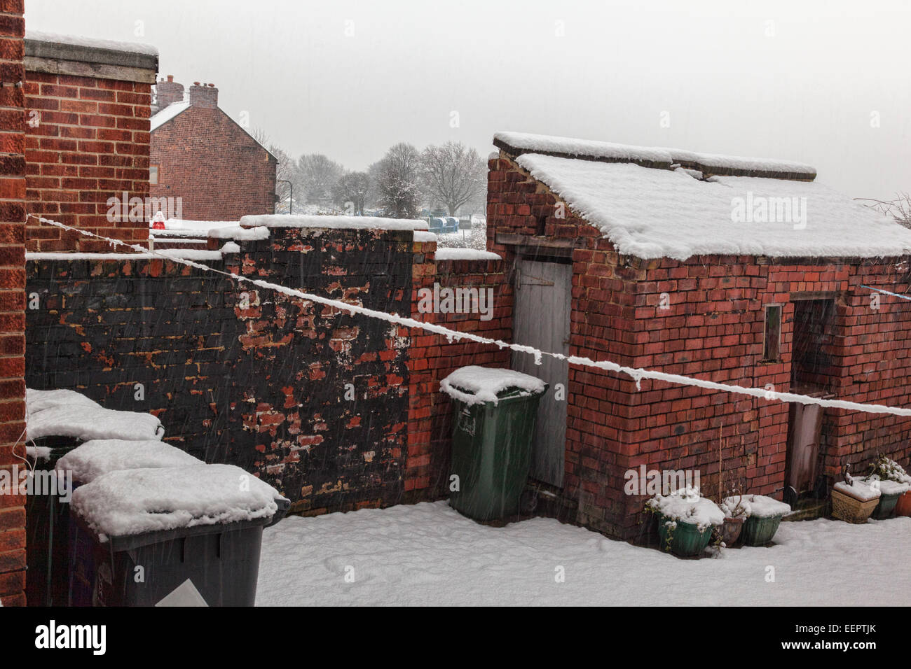 A view across a snowy back yard in Hough Lane, Wombwell,South Yorkshire. - Stock Image