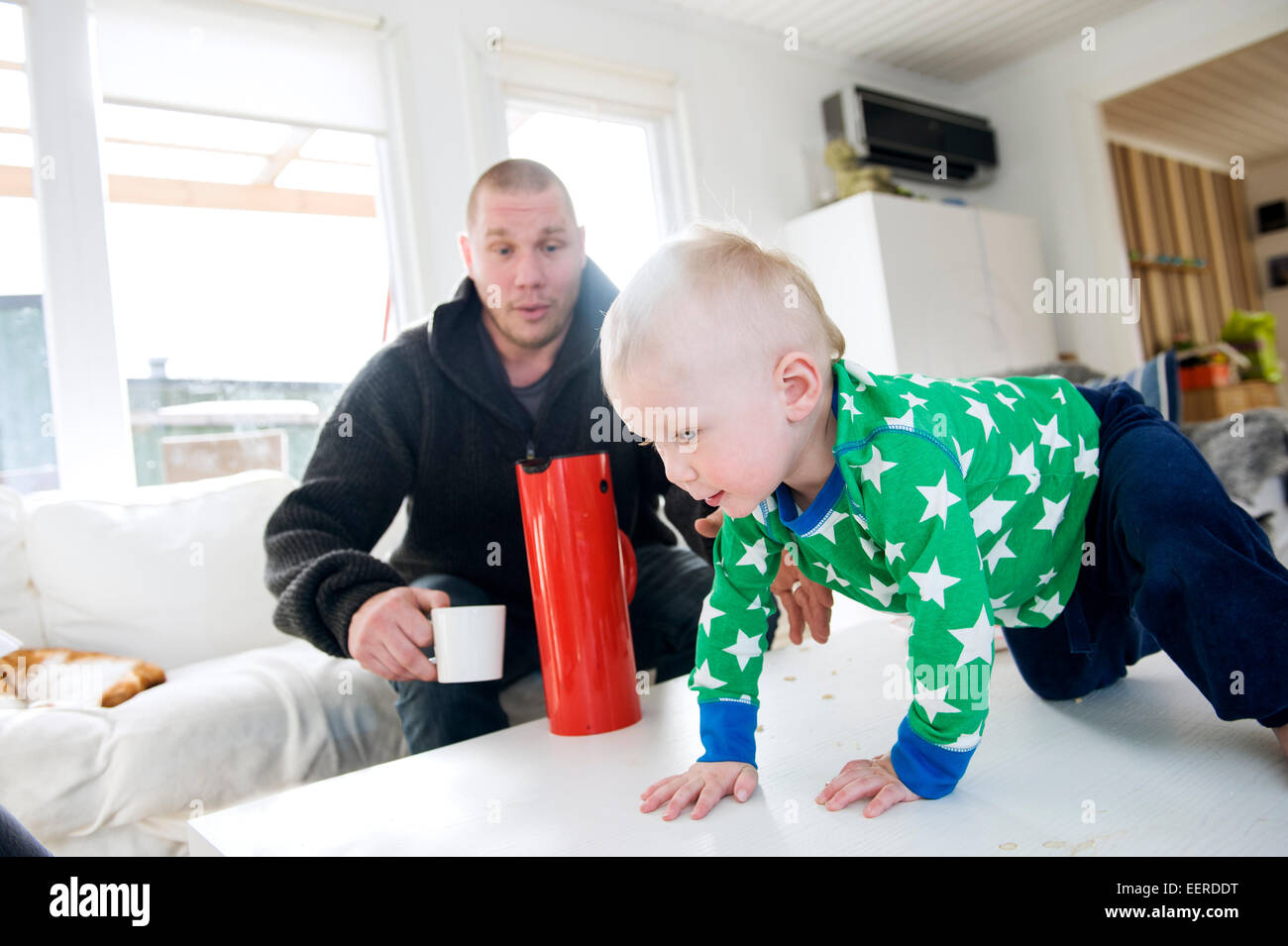 swedish father staying home with 1,5 year old son, paternity leave - Stock Image