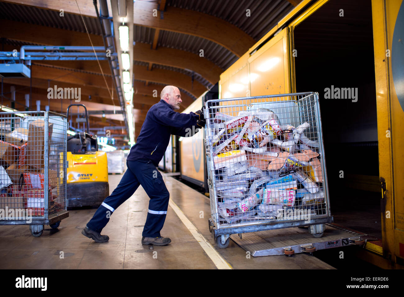 letter and packages sorting transport at Tomteboda, loading wagon, boxcar - Stock Image