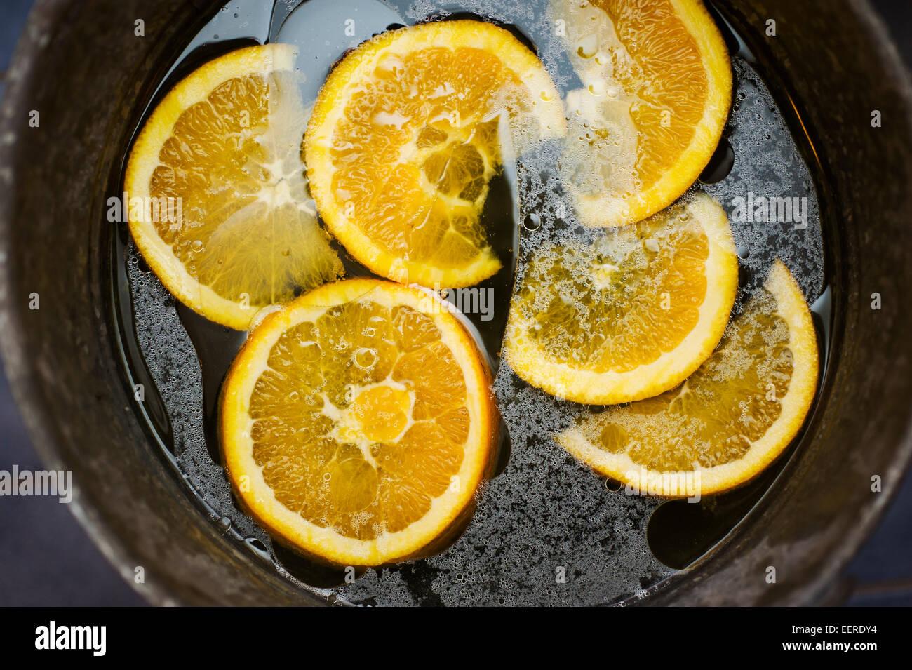 Oranges in footbath - Stock Image