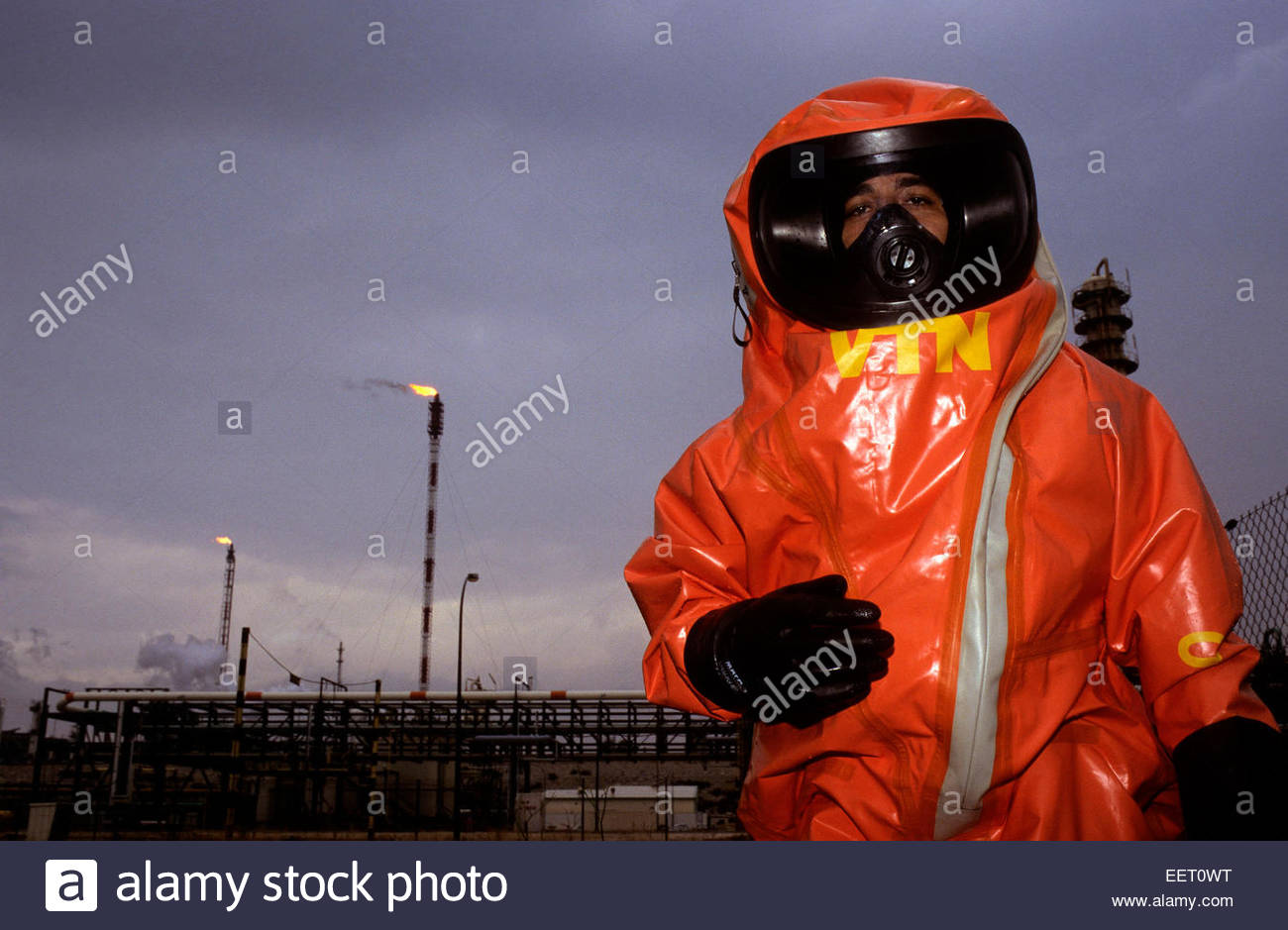Fireman on contaminated site, France. - Stock Image
