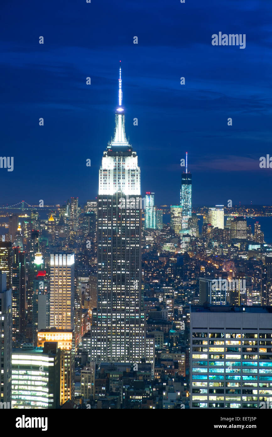 Empire state building viewed from the Rockerfeller Building at dusk Stock Photo