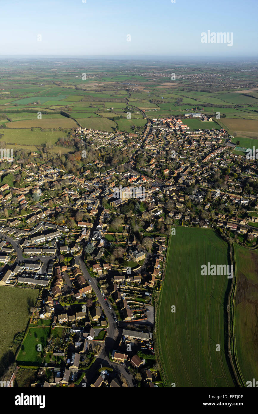 An aerial view showing the Somerset village of South Petherton in context with the surrounding rural landscape - Stock Image