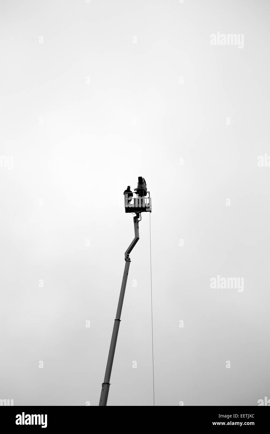 Television crew filming from crane Stock Photo