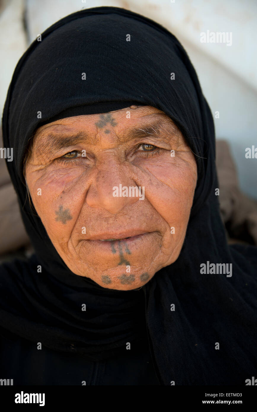 Syrian refugee woman with facial tattoos - Stock Image