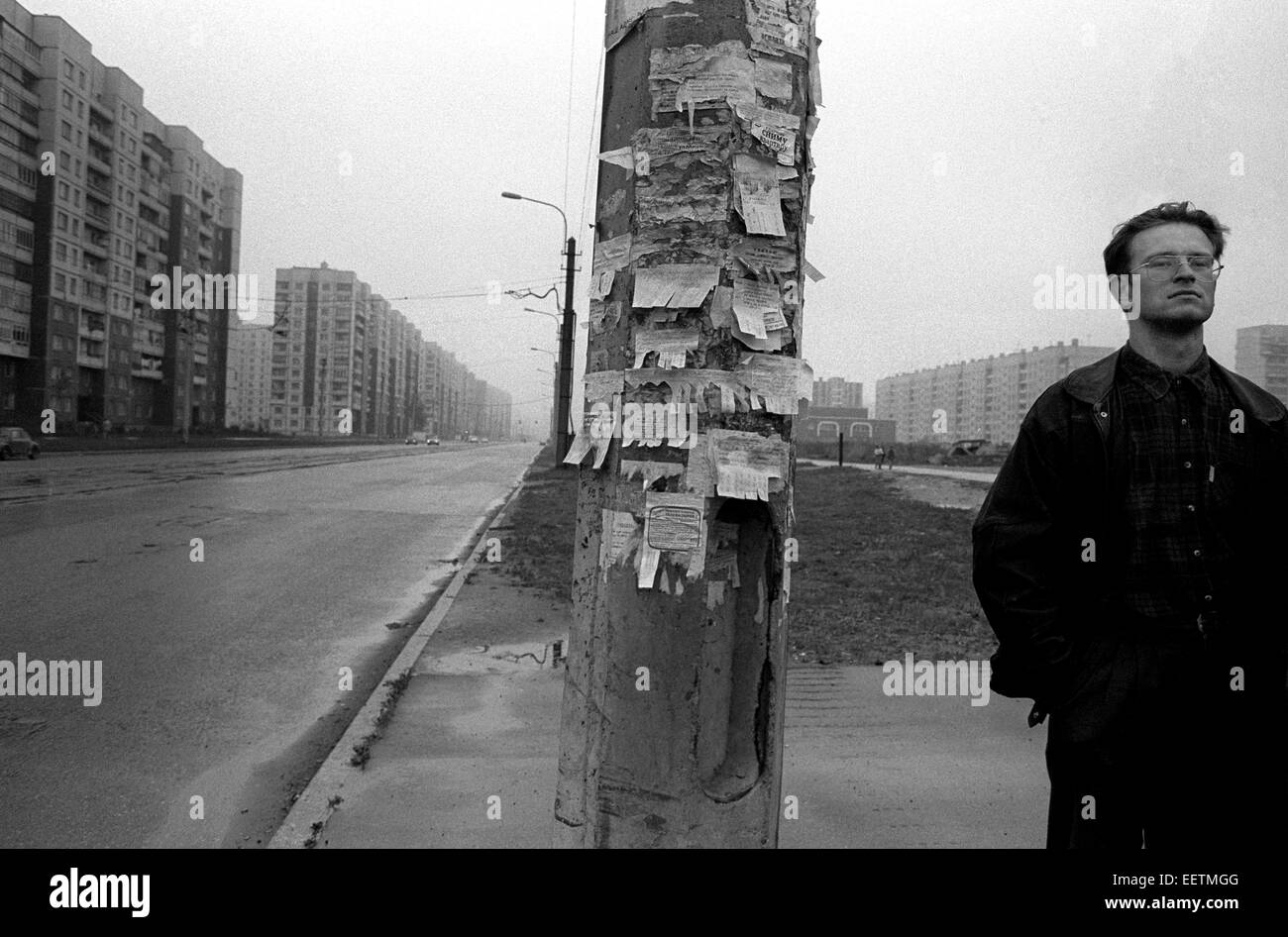 An urban Street scene in St Petersburg, Russia with notices stuck on pole - Stock Image