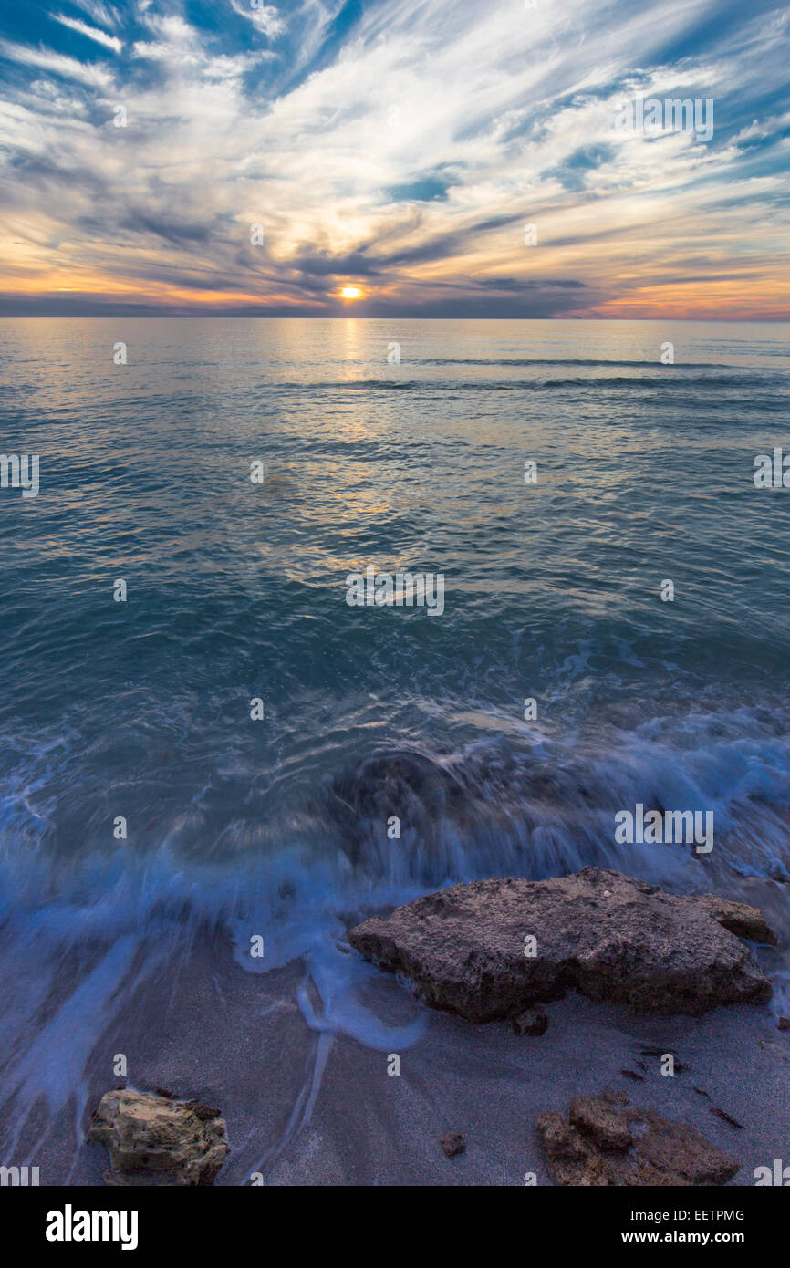 Fine white wispy clouds in sky at sunset over Gulf of Mexico at Caspersen Beach in Venice Florida - Stock Image