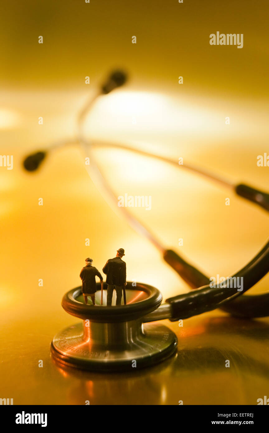 Conceptual shot of figurines of old people on a stethoscope. - Stock Image