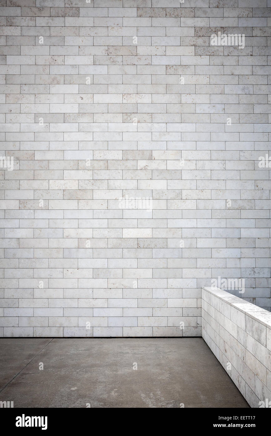 Tiled wall with a blank white bricks and concrete floor Stock Photo ...