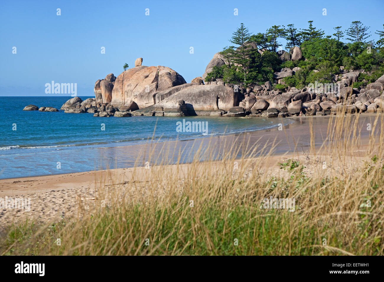 Huge boulders on the beach at Balding Bay on Magnetic Island along the Coral Sea, north-eastern coast of Queensland, - Stock Image